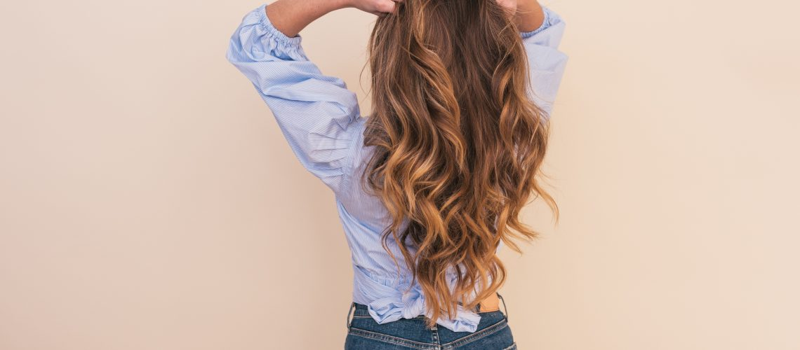 brunette woman with long curly hair